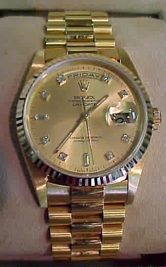 Genuine Rolex Watch - 18k solid yellow gold, genuine Rolex champagne diamond dial (8 round and 2 baguette diamond hour markers), fluted bezel, and President bracelet, oyster perpetual day-date watch (the Rolex President) - $21,400.00